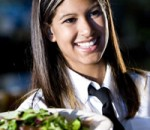cheerful waitress in restaurant