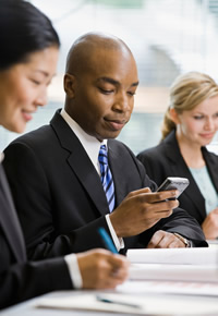 text messaging during a staff meeting in the office