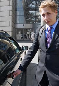 businessman opening car door