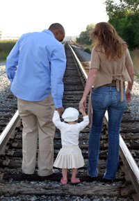 family picture on railroad tracks